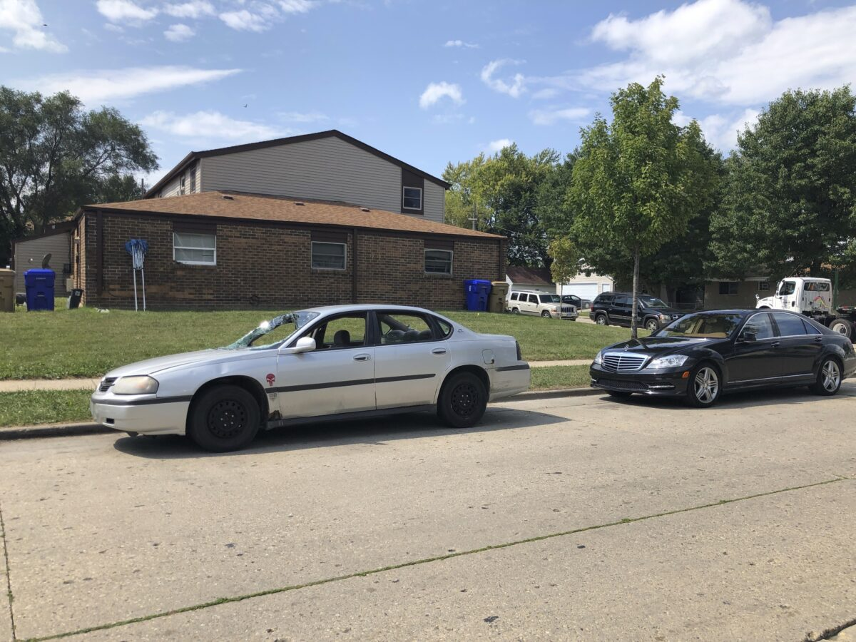 Vehicles are parked where Jacob Blake was shot by police in Kenosha
