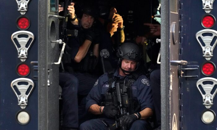 Members of the St. Louis Police Department SWAT team stage near the scene of a shooting in St. Louis., on Aug. 29, 2020. (Jeff Roberson/AP Photo)