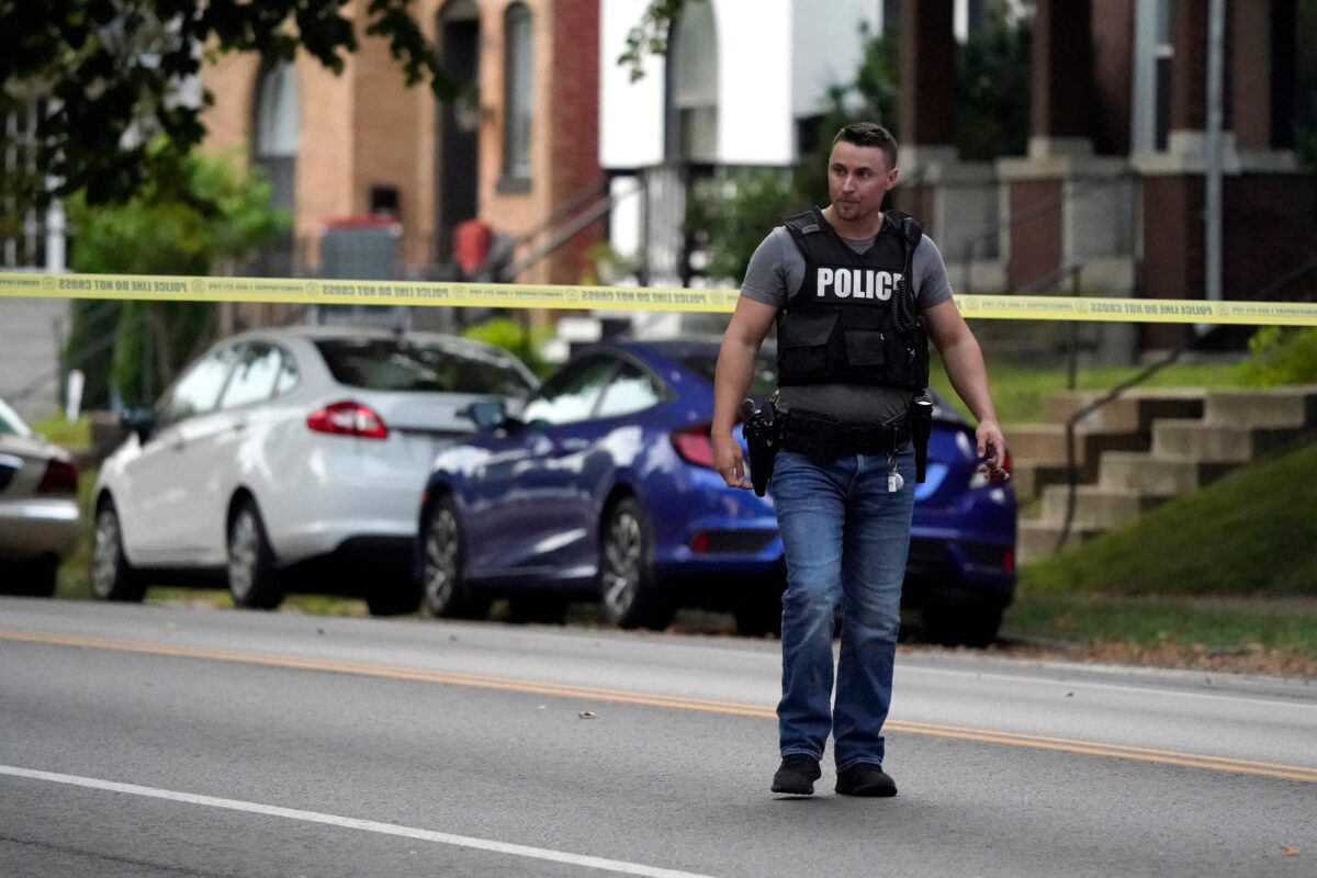 Police work near the scene of a shooting in St. Louis