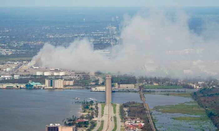 A chemical fire burns at a facility during the aftermath of Hurricane Laura, on Aug. 27, 2020, near Lake Charles, La. (AP Photo/David J. Phillip)