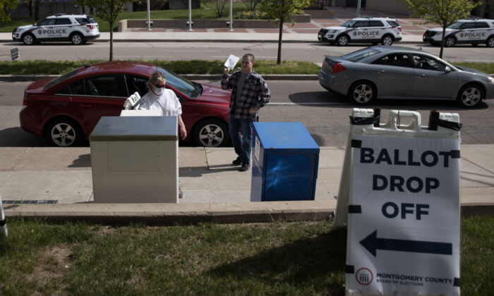 Ohio voters drop off their ballots at the Board of Elections in Dayton, Ohio, on April 28, 2020.  (MEGAN JELINGER/AFP via Getty Images)