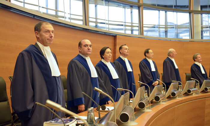 The judges of the International Tribunal for the Law of the Sea (ITLOS), stand in the courtroom in Hamburg on Nov. 22, 2013. (Patrick Lux/AFP via Getty Images)