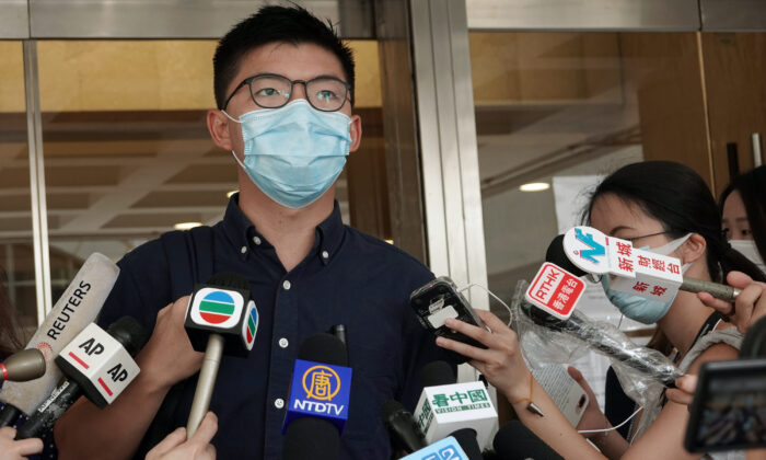 Pro-democracy activist Joshua Wong speaks to the media as he arrives at the High Court to lodge a judicial review over his disqualification from the 2019 district council elections, in Hong Kong on Aug. 7, 2020. (Joyce Zhou/Reuters)