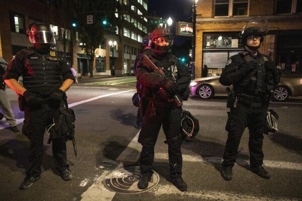 Portland police stand guard