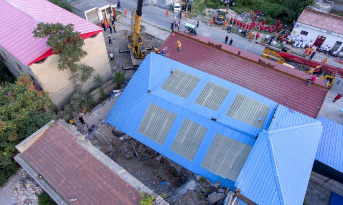The site of a collapsed two-story restaurant in Xiangfen County of Linfen City, northern China's Shanxi Province on Aug. 29, 2020. (Yang Chenguang/Xinhua via AP)