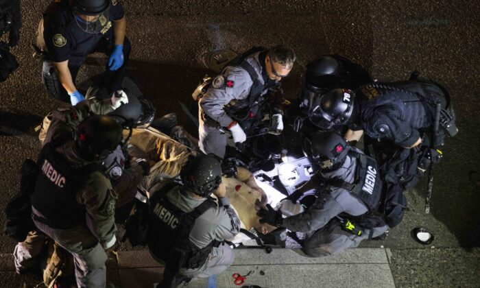 A man is treated by medics after being shot during a confrontation in Portland, Ore., on Aug. 29, 2020. (Paula Bronstein/AP Photo)