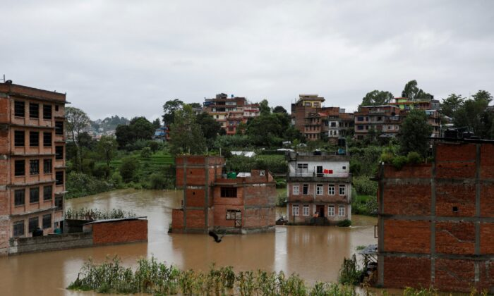 Houses are seen submerged in the waters as a river overflows due to incessant rainfall in Bhaktapur, Nepal, on July 20, 2020. (Navesh Chitrakar/Reuters)