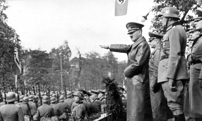 German troops parade in front of Adolf Hitler and Nazi generals in Warsaw on Oct. 5, 1939, a month after the invasion of Poland that began the Second World War. (Public Domain)