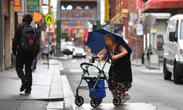 A lady crossing the street in Melbourne's Chinatown February 14, 2020 (William West/AFP via Getty Images)