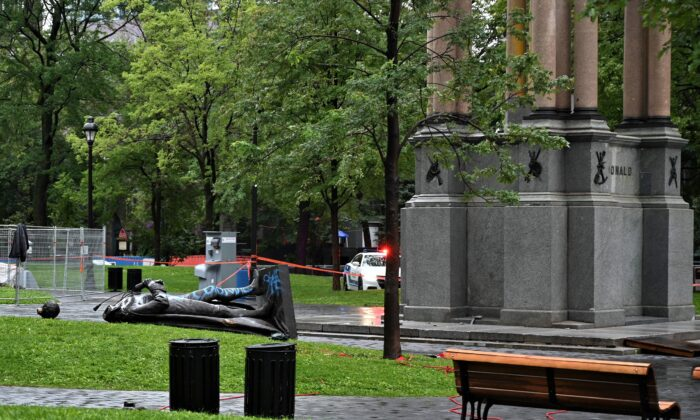 The statue of Sir John A. Macdonald lies on the ground, with its head a few metres away, at Place du Canada in Montreal after it was torn down by activists  on Aug. 29, 2020. (Eric Thomas/AFP via Getty Images)