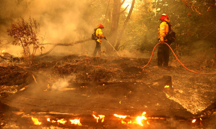 Firefighters extinguish spot fires in Fairfield, Calif., on Aug. 19, 2020. (Justin Sullivan/Getty Images)