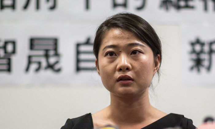 "Grace Geng, daughter of Gao Zhisheng, a renowned human rights lawyer in China, speaks about her father's book ""A Human Rights Lawyer under Torture the auto narratives of Gao Zhisheng,"" during a press conference at the Legislative Council Complex in Hong Kong on June 14, 2016. (Anthony Wallace/AFP via Getty Images)"