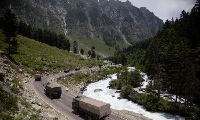 An Indian army convoy moves on the Srinagar-Ladakh highway at Gagangeer, north-east of Srinagar, India, on June 17, 2020. (Mukhtar Khan/AP Photo)