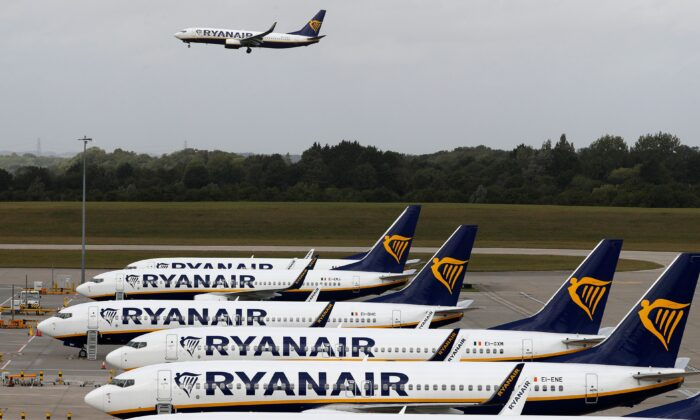 Ryanair aircraft are pictured at Stansted airport, northeast of London on Aug. 20, 2020. (Adrian Dennis/AFP via Getty Images)