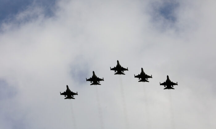 Taiwanese F-16 fighter jets fly in formation during an inauguration ceremony in Taichung, Taiwan on Aug. 28, 2020. (Ann Wang/File Photo via Reuters)