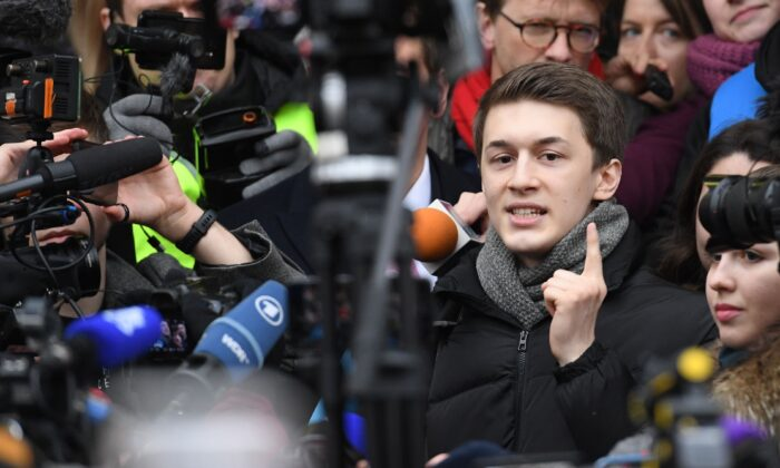 Russian student and blogger Yegor Zhukov reacts outside Moscow's Kuntsevsky district court after getting his suspended sentence, in Moscow, on Dec. 6, 2019. (Kirill Kudryavtsev/AFP via Getty Images)
