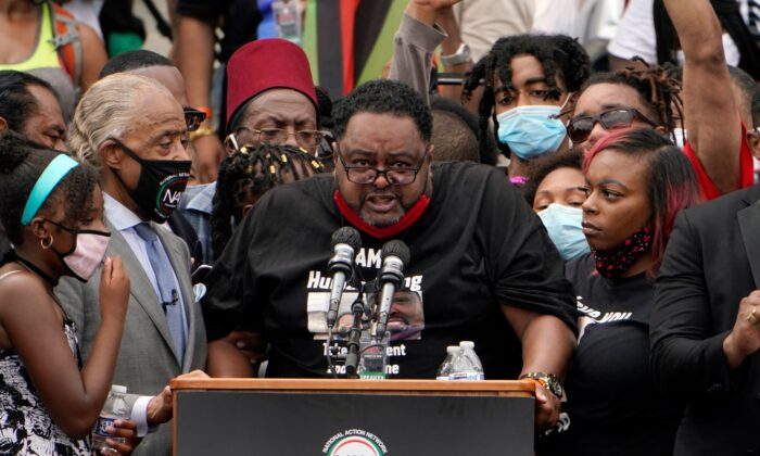 """Jacob Blake Sr., father of Jacob Blake, Jr., speaks at the Lincoln Memorial during the """"Commitment March: Get Your Knee Off Our Necks"""" protest in Washington on Aug. 28, 2020. (Jacquelyn Martin/Pool/AFP via Getty Images)"""