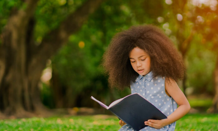 You can instill a love of reading by encouraging children to read about the topics they're interested in.  (Ultimate Hero/Shutterstock)