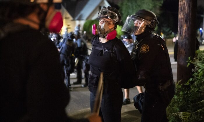 An individual is arrested amid rioting in Portland, Ore., on Aug. 30, 2020. (Nathan Howard/Getty Images)