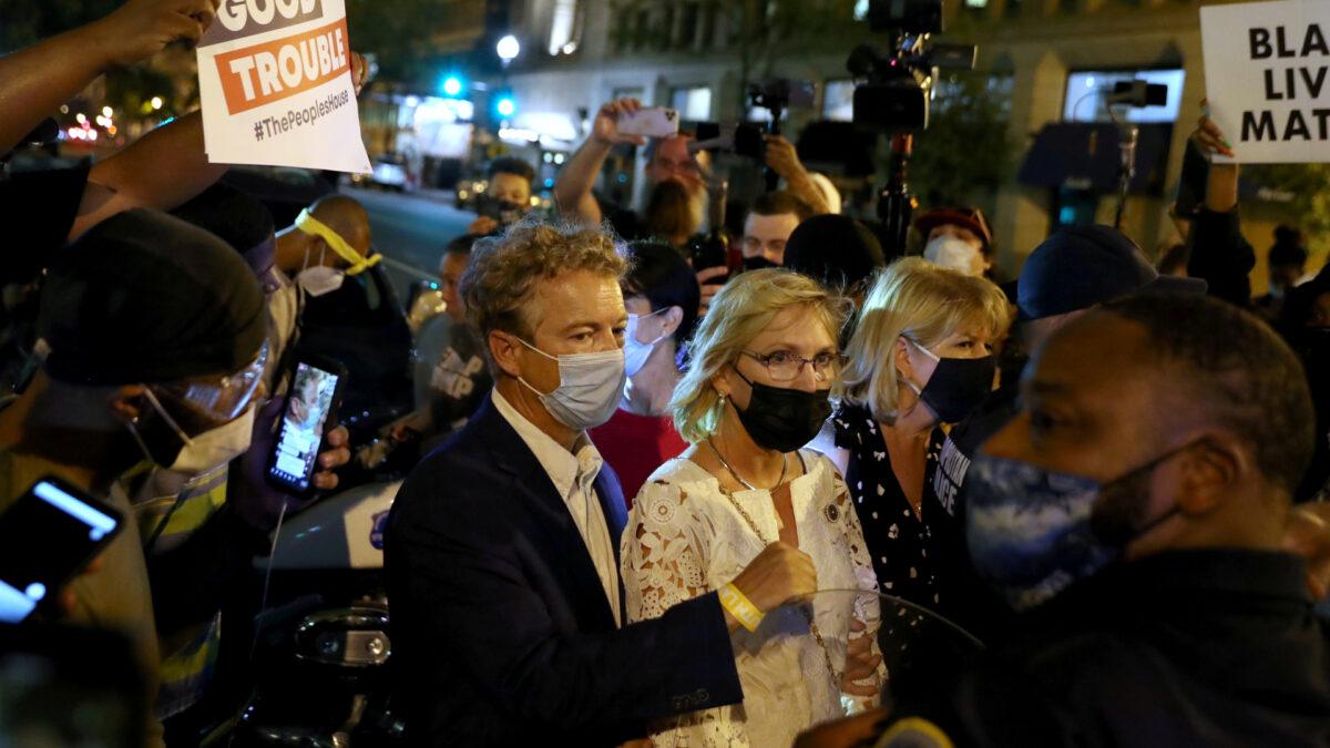 Protesters confront U.S. Senator Rand Paul