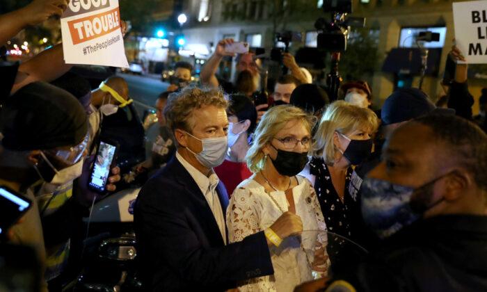 A mob confronts Sen. Rand Paul (R-Ky.) in Washington, Aug. 28, 2020. (Leah Millis/Reuters)