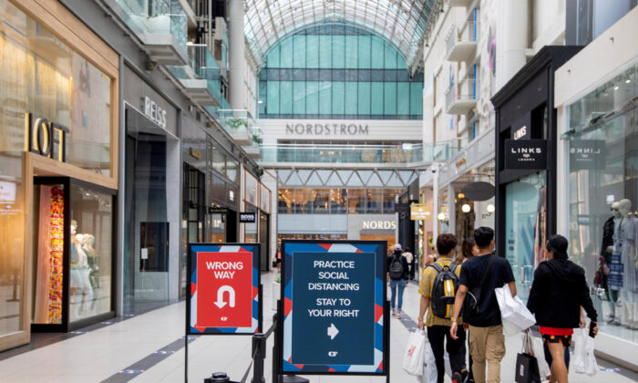 People walk in the Eaton Centre shopping mall after the provincial phase 2 of reopening from COVID-19 restrictions began in Toronto on June 24, 2020. (REUTERS/Carlos Osorio/File Photo)