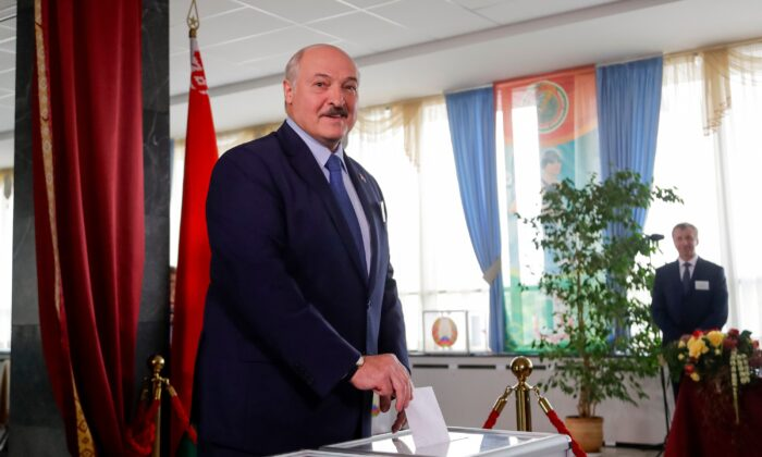 Belarusian President Alexander Lukashenko casts his ballot at a polling station during the election in Minsk, Belarus, on Aug. 9, 2020. (Sergei Grits/AP Photo)