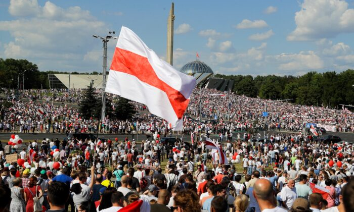 Belarusian opposition supporters rally in central Minsk, Belarus, on Aug. 16, 2020. (Sergei Grits/AP Photo)