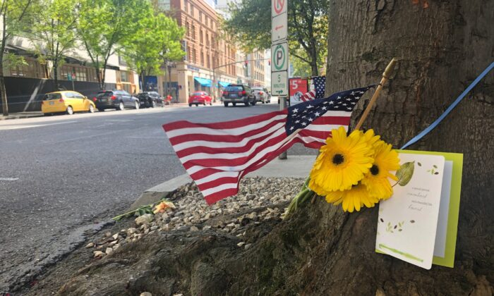 A small memorial to the fatal shooting victim, 39-year old Aaron J. Danielson, is shown at the site where he was killed in Portland, Ore., on Aug. 31, 2020. (Gillian Flaccus/AP Photo)