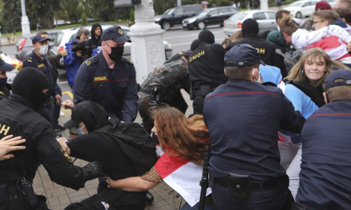 Police detain students during a protest against presidential election results in Minsk, Belarus, on Sept. 1, 2020. (AP Photo)