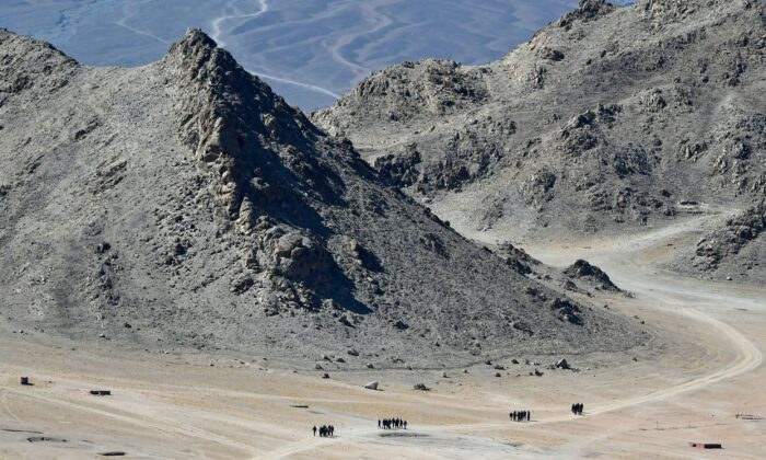 Indian soldiers walk in the foothills of a mountain range near Leh on June 23, 2020. (TAUSEEF MUSTAFA/AFP via Getty Images)
