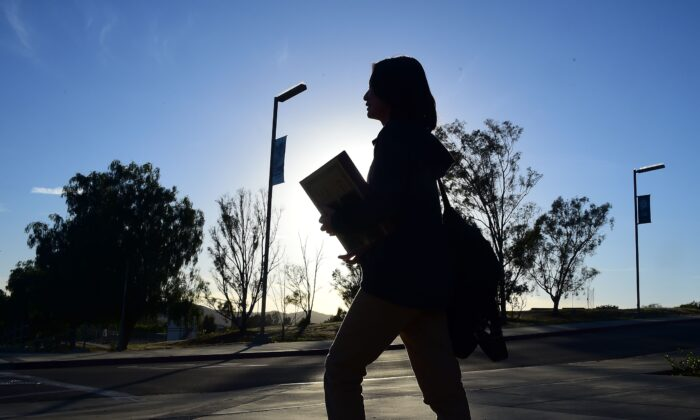 A student walks on the campus of a school in Temecula, Calif., on March 23, 2016. (Frederic J. Brown/AFP via Getty Images)