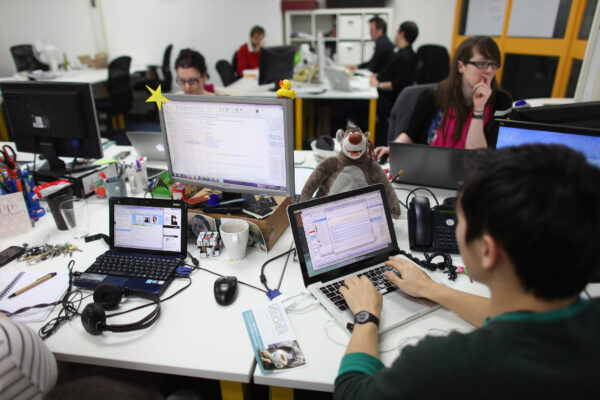 People work at computers in TechHub, a busy office space for technology start-up in London on March 15, 2011.