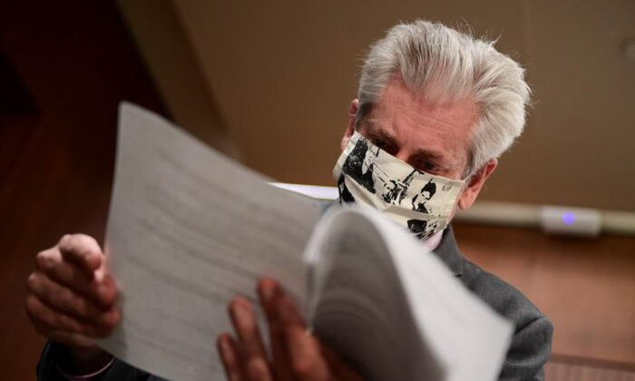 NDP MP Charlie Angus speaks to reporters as he thumbs through a document following a press conference on Parliament Hill in Ottawa on Sept. 1, 2020. (Sean Kilpatrick/The Canadian Press)