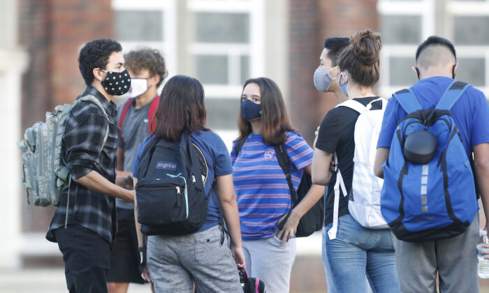 High school students in line to have temperature checked before entering the building in Tampa, Fla., on Aug. 31, 2020. (Octavio Jones/Getty Images)