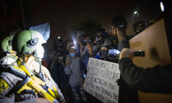 Protesters clash with deputies of the Los Angeles Sheriff's Department during protests following the death of Dijon Kizzee on Monday, Aug. 31, 2020, in Los Angeles, Calif. (Christian Monterrosa/AP Photo)