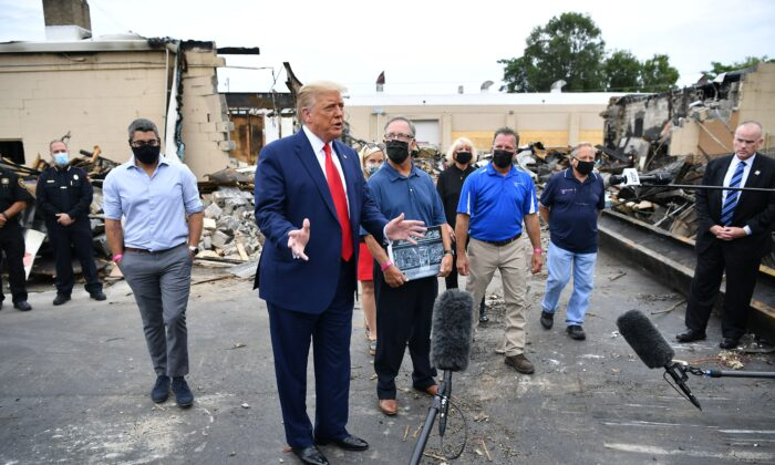 President Donald Trump views property damaged during riots in Kenosha, Wis., on Sept. 1, 2020. (Mandel Ngan/AFP via Getty Images)