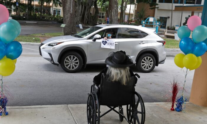 Frances Reaves, in car, pays a visit to her friend Margaret Choinacki, foreground, 87, at Miami Jewish Health in Miami, Fla., on July 17, 2020. (Wilfredo Lee/AP Photo)
