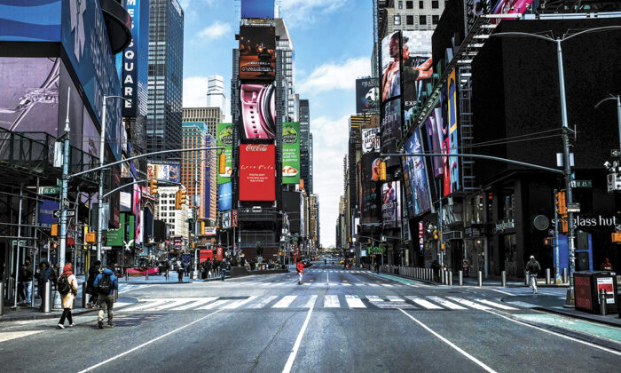 Times Square stands mostly empty as much of New York is void of cars and pedestrians amid the CCP virus pandemic on March 22, 2020. (Spencer Platt/Getty Images)