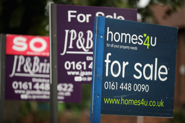 For Sale boards stand outside homes in Didsbury in Manchester, England
