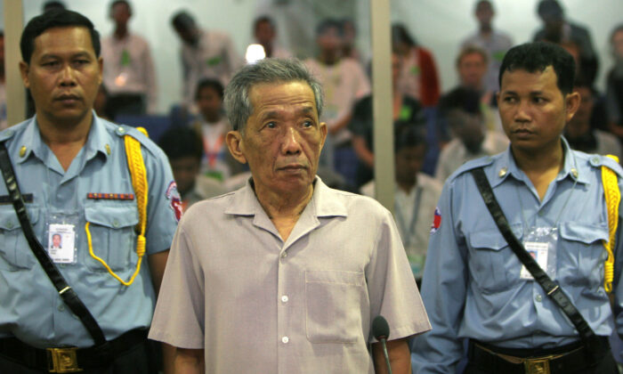 Former Khmer Rouge S-21 prison chief Kaing Guek Eav, better known as Duch, stands in a courtroom during a pre-trial in Phnom Penh on Dec. 5, 2008. (Tang Chhinsothy/Pool (CAMBODIA)/Reuters)