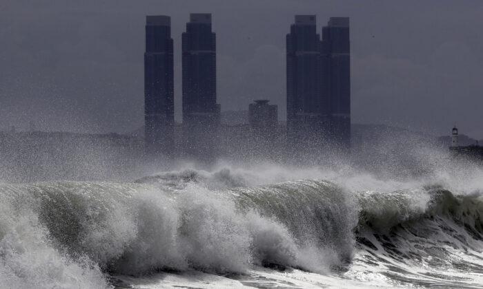 High waves crash onto Haeundae Beach in Busan, South Korea, on Aug. 26, 2020. (Jo Jong-ho/Yonhap via AP)