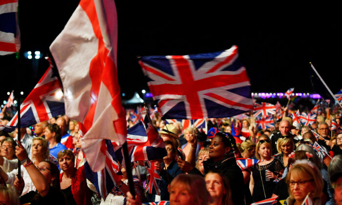 In this file photo, revelers wave British flags as they enjoy The Last Night of the Proms celebration in Hyde Park, London, on Sept. 14, 2018. (Reuters/Dylan Martinez)