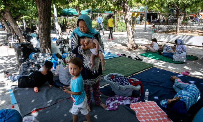 Migrants sit at central Victoria square in Athens on Sept. 2, 2020. (Yorgos Karahalis/AP Photo)