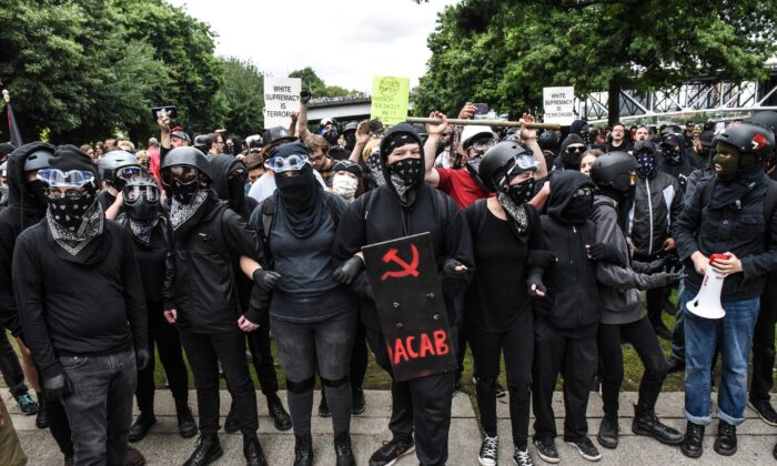 Antifa members line up to challenge a rally in Portland, Ore., on Aug. 17, 2019. (Stephanie Keith/Getty Images)