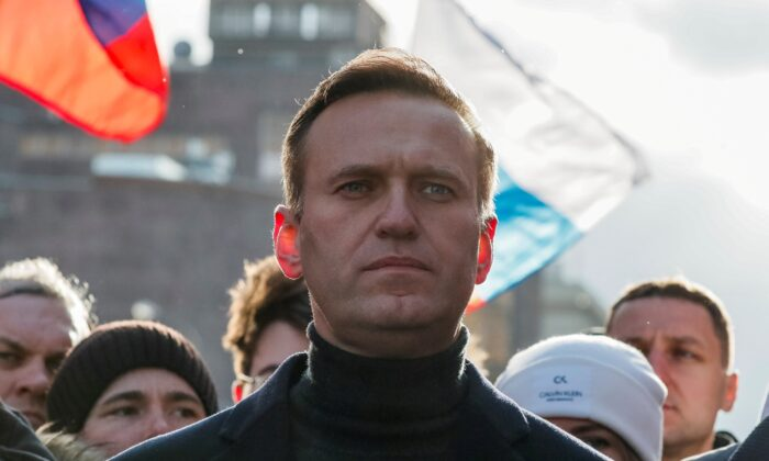 Russian opposition politician Alexei Navalny takes part in a rally to mark the 5th anniversary of opposition politician Boris Nemtsov's murder and to protest against proposed amendments to the country's constitution, in Moscow on Feb. 29, 2020. (Shamil Zhumatov/Reuters)