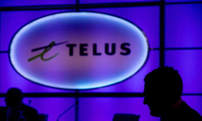 A Telus sign is pictured at the company's annual meeting in Vancouver in a file photo. (Darryl Dyck/The Canadian Press)