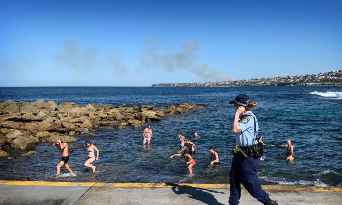Swimmers are ordered from the water by Police at Clovelly Beach on April 24, 2020 in Sydney, Australia. (Ryan Pierse/Getty Images)