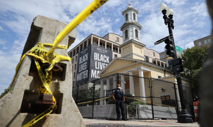 Police and concrete barricades surround St. John's Episcopal Church near Lafayette Square during the March on Washington August 28, 2020 in Washington. (Chip Somodevilla/Getty Images)