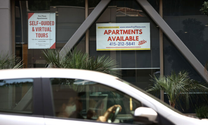 A car drives by a building advertising apartment leases in San Francisco on Sept. 1, 2020. (Justin Sullivan/Getty Images)